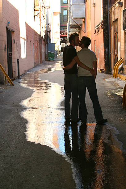 kiss in the alley stock photo