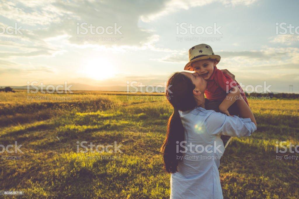 Kiss in the cheek stock photo
