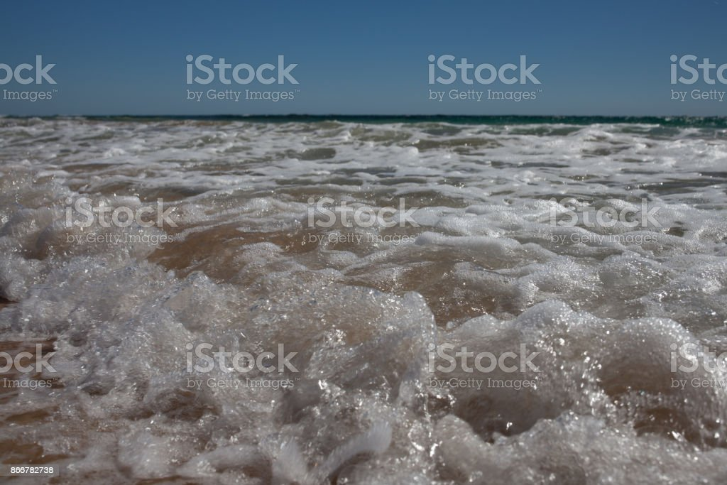 kiss of a baby wave stock photo