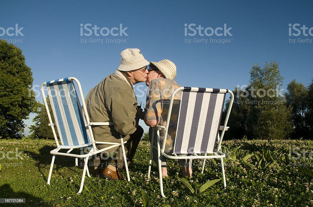 kiss of old couple royalty-free stock photo