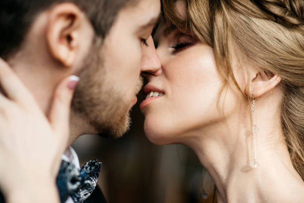 Kiss of the man and women stock photo