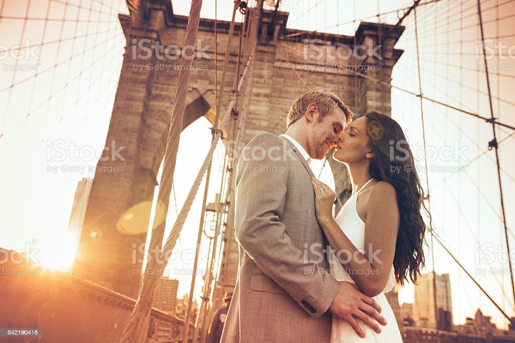 Kiss on Brooklyn Bridge stock photo