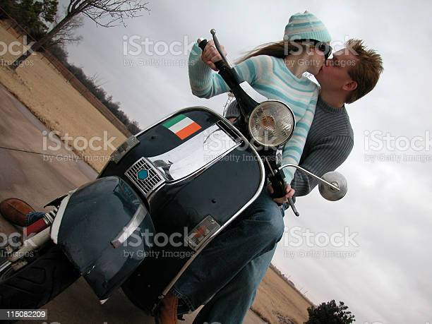 kiss on scooter