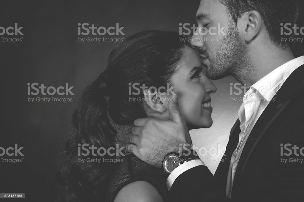 Kiss on the forehead stock photo