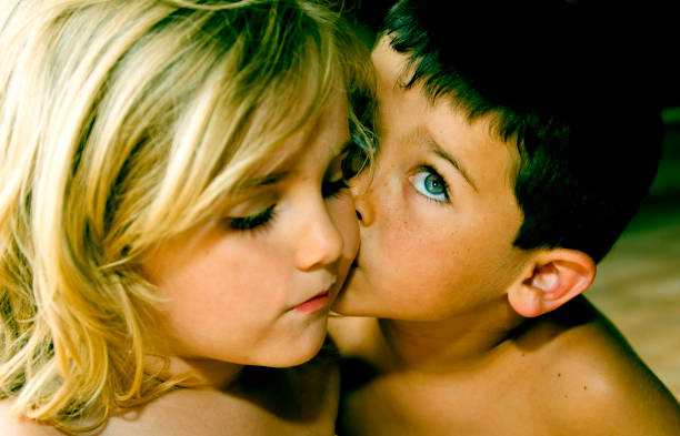 kiss - little girls little boys kissing love stock photos and pictures