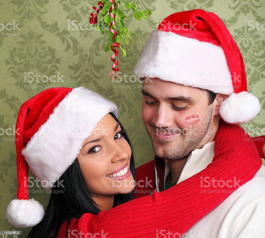 Kiss Under The Mistletoe stock photo