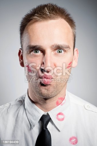 istock kissed young man 136194439