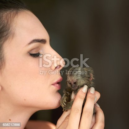 Cropped shot of an attractive young woman posing with a pigmy marmoset