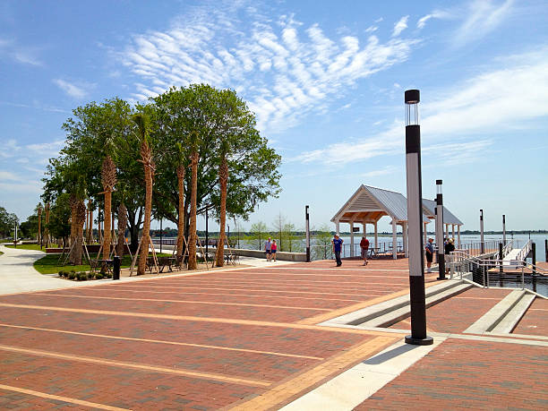 kissimmee lakefront park - main walkway and dock - kissimmee stock photos and pictures