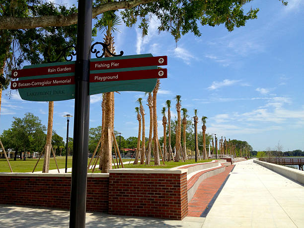 kissimmee lakefront park - signage and walkway - kissimmee stock photos and pictures