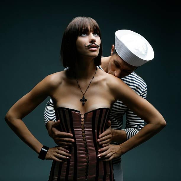 küssen eine schönheit mit schnurrbart - matrosin kostüm stock-fotos und bilder