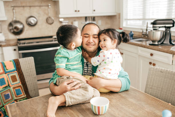Kissing a best dad Kids hugging a father filipino ethnicity stock pictures, royalty-free photos & images