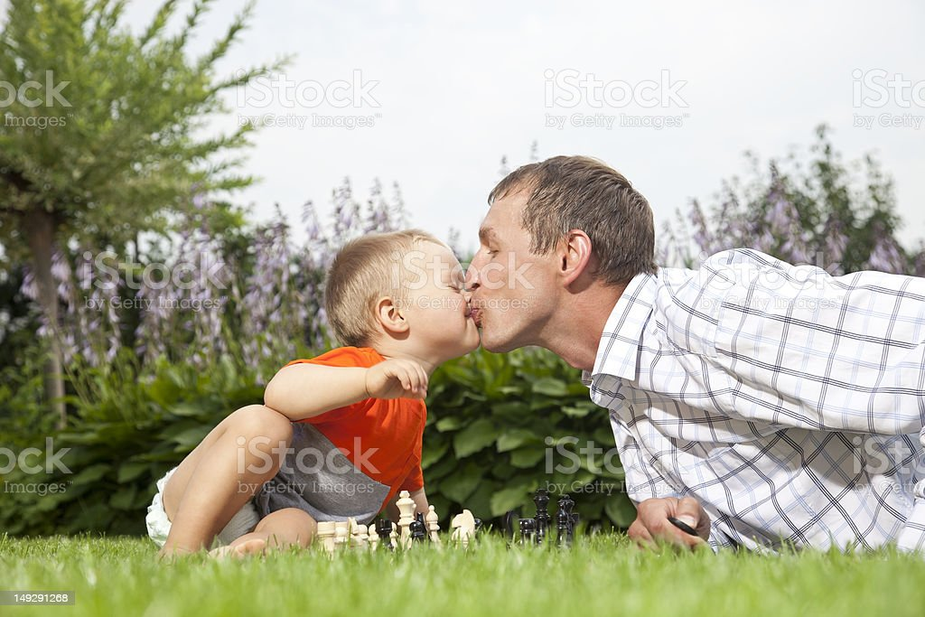 Kissing and playing chess royalty-free stock photo