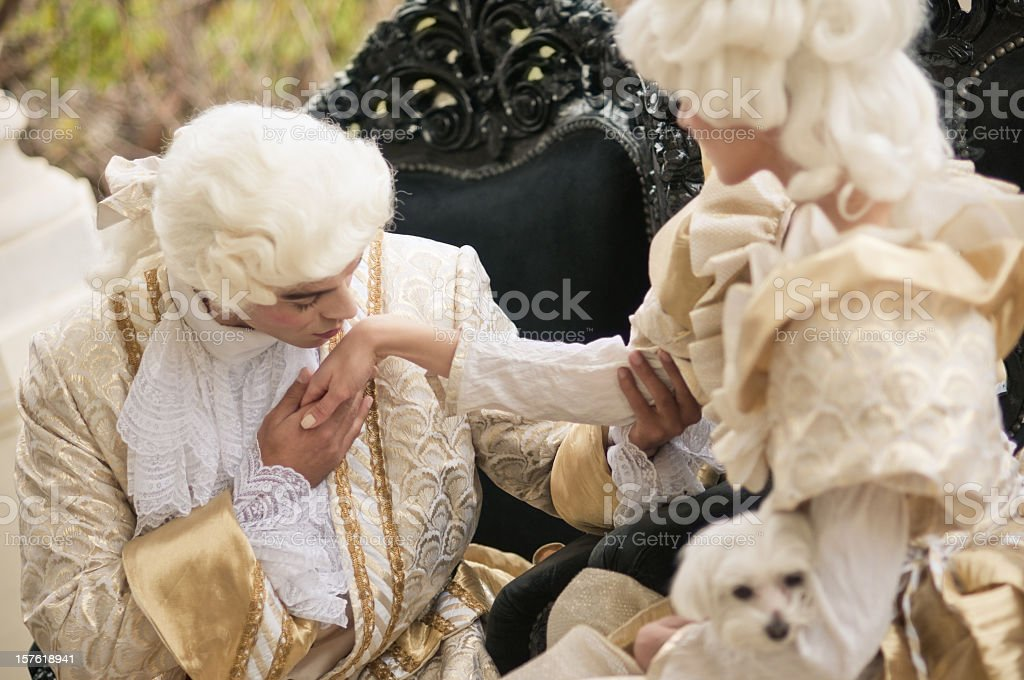 Kissing Hand in Old French Costumes royalty-free stock photo