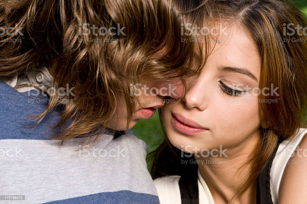 Kissing her royalty-free stock photo