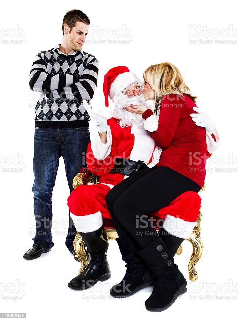 Kissing Santa Claus stock photo