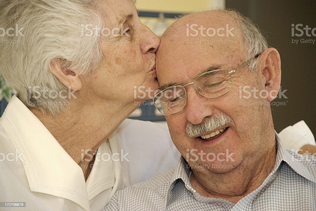 Kissing Seniors royalty-free stock photo