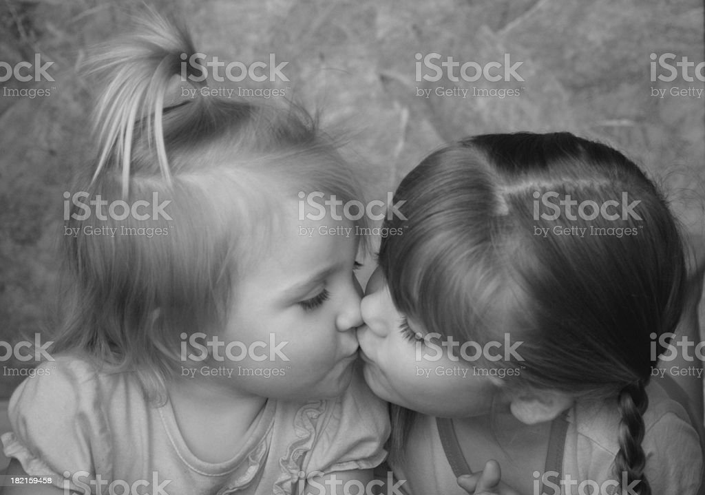 Kissing Sisters stock photo