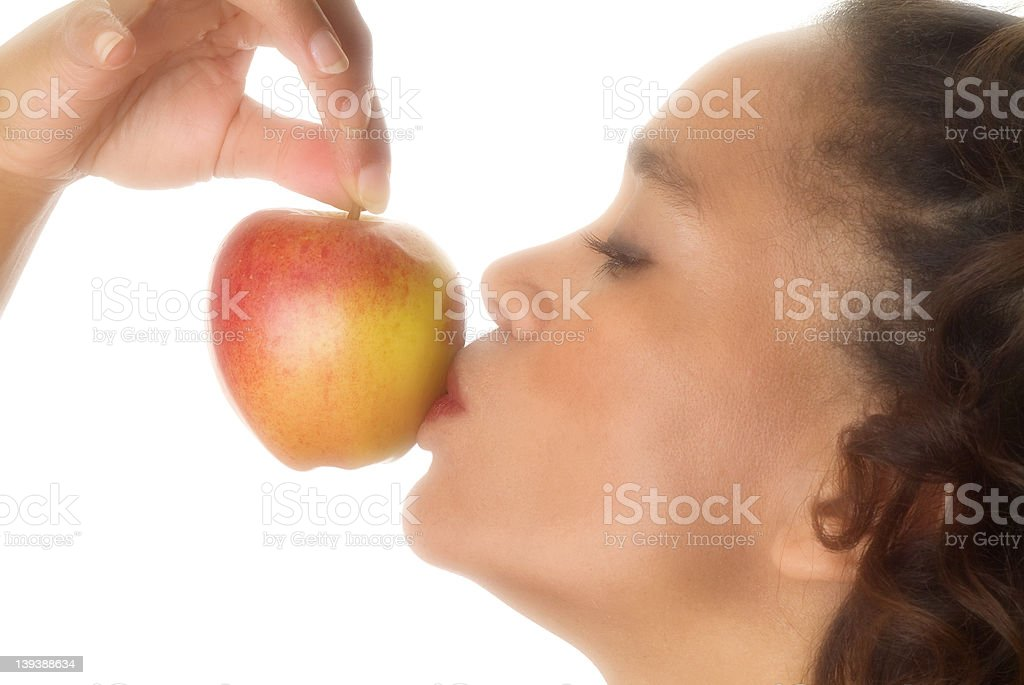 Kissing the apple royalty-free stock photo