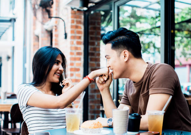 Kissing the ring on his new fiance Marriage, Proposal, Bonding, Couple - Man proposing to his girlfriend at a sidewalk cafe in the morning. kissinghand stock pictures, royalty-free photos & images