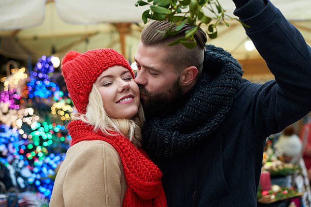 Kissing under the mistletoe is a tradition stock photo