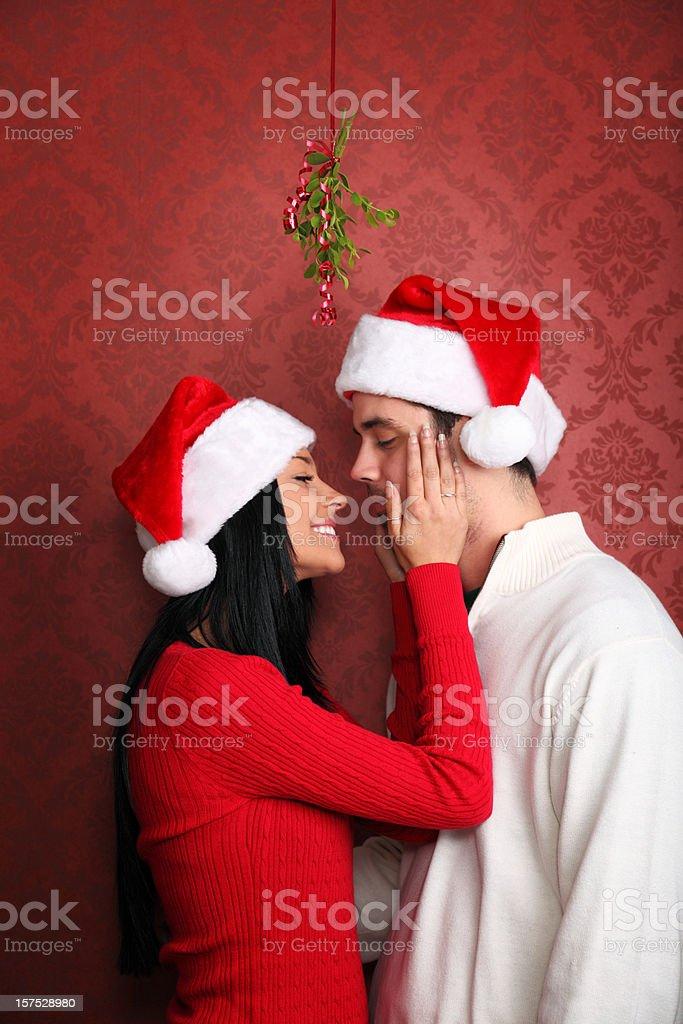Kissing Under The Mistletoe royalty-free stock photo