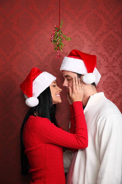 Kissing Under The Mistletoe stock photo