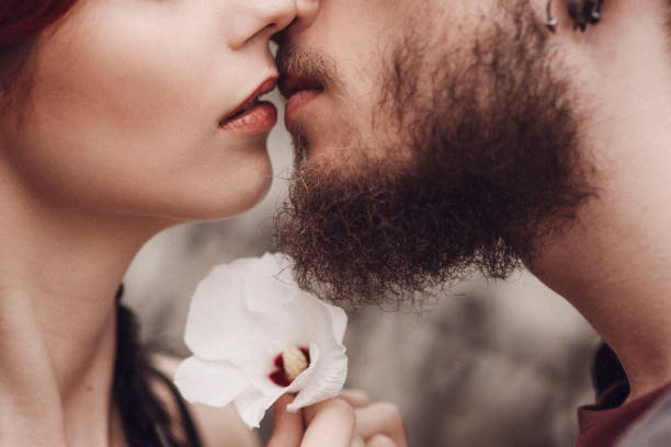 Kissing young couple, romantic relationship stock photo