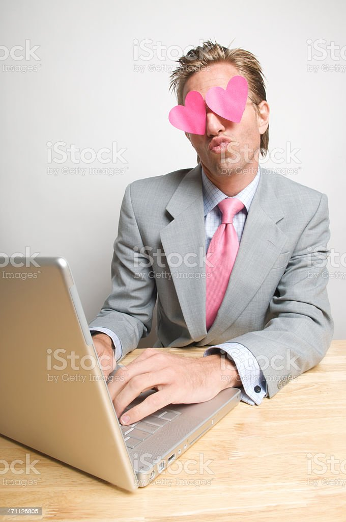 Kissy Guy in Suit on Computer royalty-free stock photo