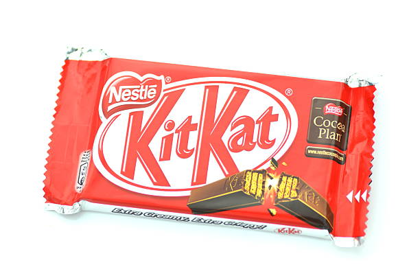 kit kat chocolate bar isolated on white background - kit kat stock photos and pictures
