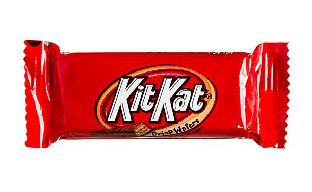 kit kat crisp wafer sealed chocolate bar - kit kat stock photos and pictures