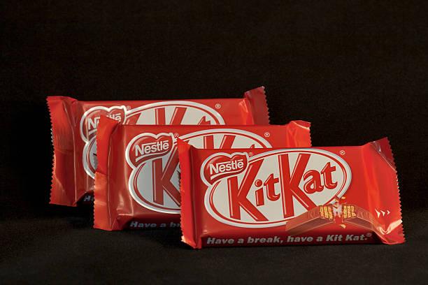 kit kat nestle chocolate bars - kit kat stock photos and pictures