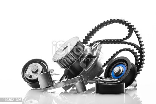 kit of timing belt with rollers on a white background