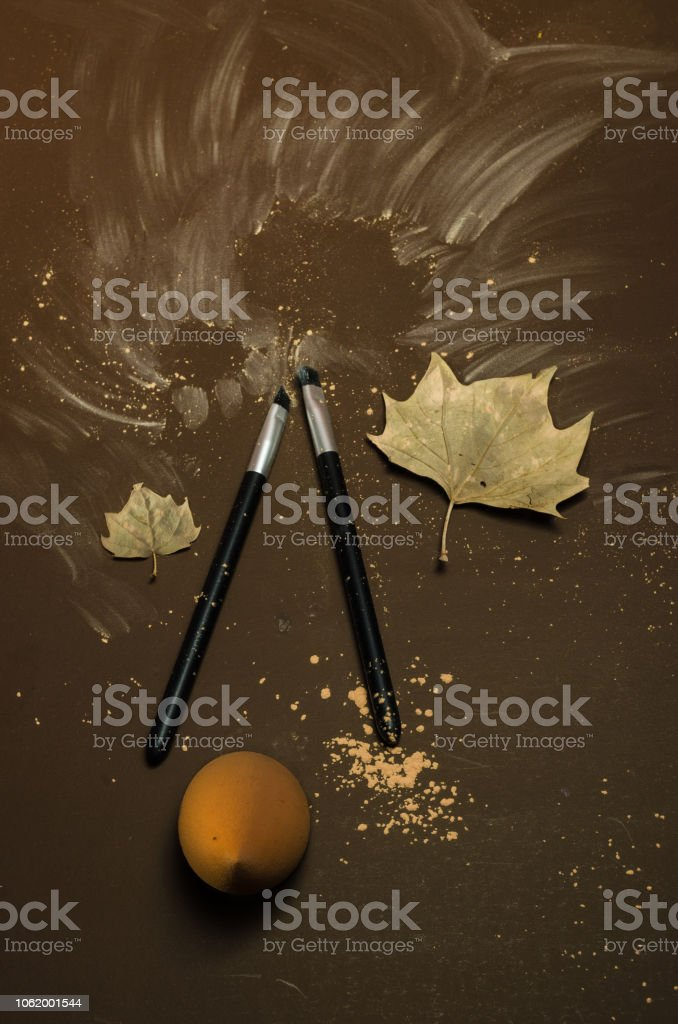 Kit of two make-up brushes with autumn seasonal theme, on a isolated colored coffee background stock photo