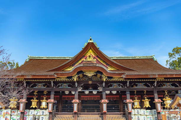 Kitano Tenmangu Shrine Kyoto, Kyoto, Japan - January 8 2019 : The Main Hall of the Kitano Tenmangu Shrine, built in 947 It is popular with students praying for success in exams because the deity was in his life a man of literature and knowledge. shinto shrine stock pictures, royalty-free photos & images