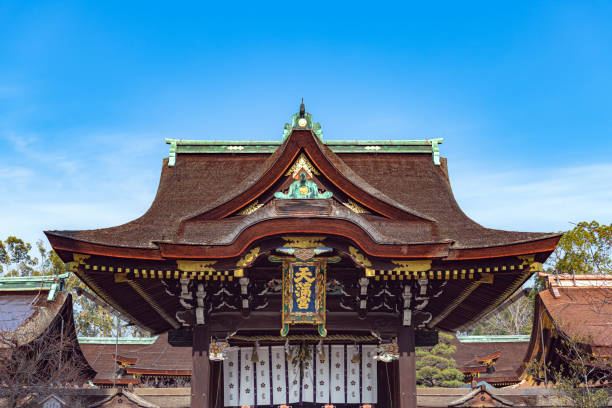 Kitano Tenmangu Shrine Kyoto, Kyoto, Japan - January 8 2019 : Sankomon Gate of the Kitano Tenmangu Shrine, built in 947 It is popular with students praying for success in exams because the deity was in his life a man of literature and knowledge. shinto shrine stock pictures, royalty-free photos & images