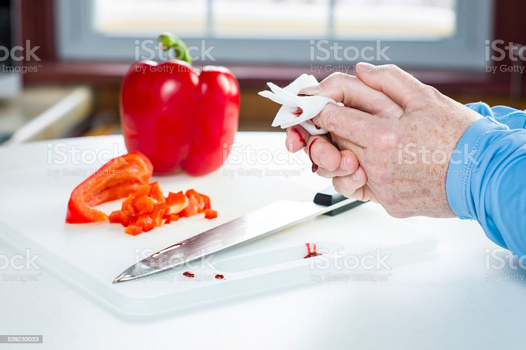 Kitchen Accident with Knife and Blood, First Aid. stock photo
