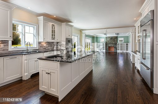 New construction with open floor plan of a kitchen, breakfast nook and living room.