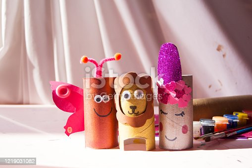 A butterfly, a lion and a unicorn made out of kitchen and toilet roll tubes