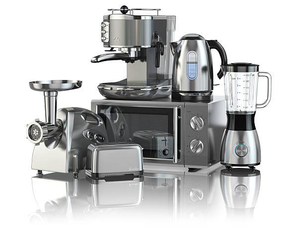 Kitchen appliances. Blender, toaster, coffee machine, meat ginde stock photo