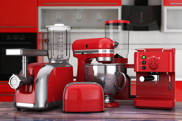 Kitchen Appliances Set. Red Blender, Toaster, Coffee Machine, Meat Ginder, Food Mixer and Coffee Grinder. 3d Rendering Kitchen Appliances Set. Red Blender, Toaster, Coffee Machine, Meat Ginder, Food Mixer and Coffee Grinder on a wooden table. 3d Rendering blender stock pictures, royalty-free photos & images