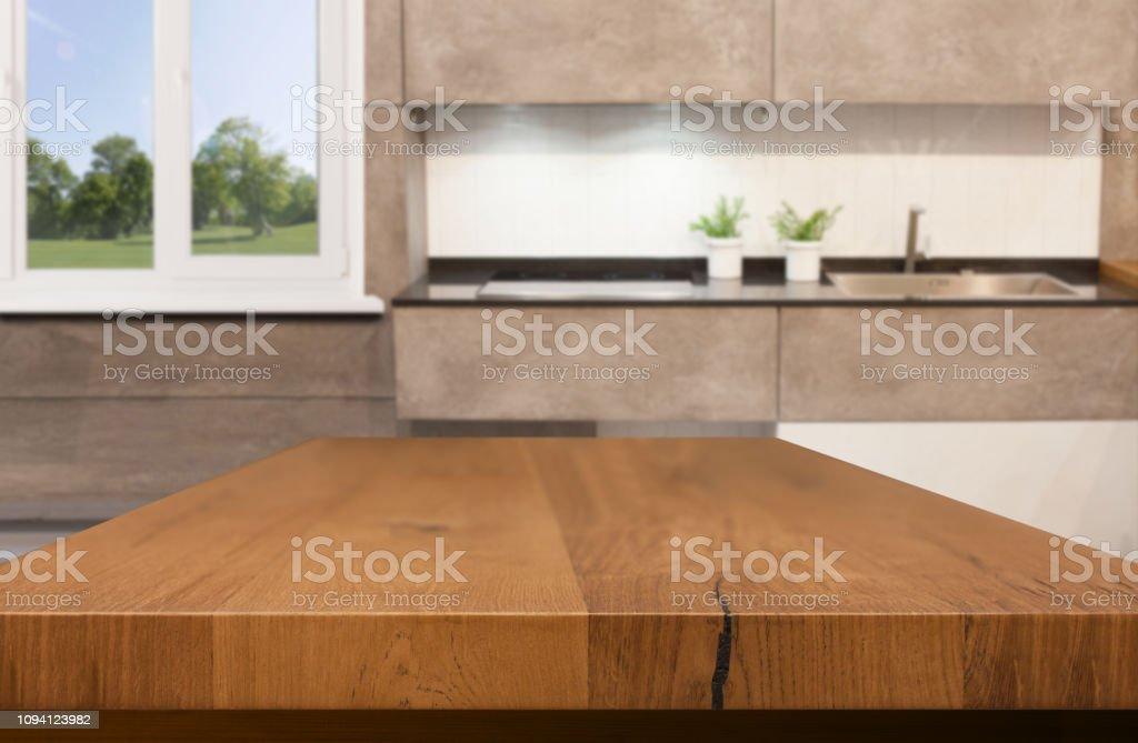 Kitchen, background. Empty textured wooden table and kitchen window...