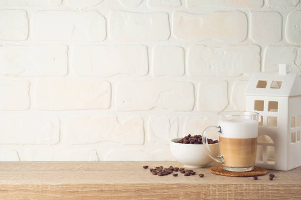 Kitchen background with coffee cup and house decor on wooden shelf stock photo