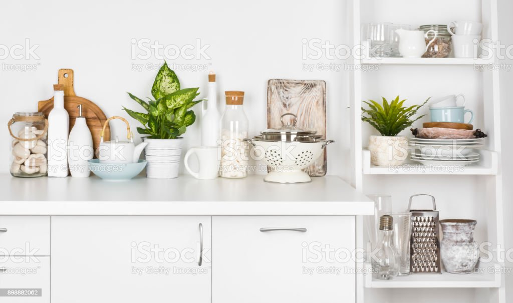 Kitchen bench and shelf with various utensils on white background stock photo