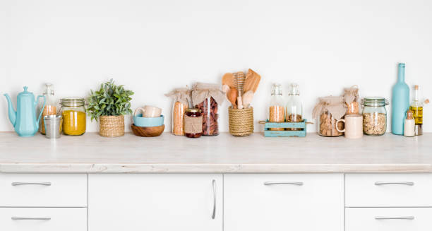 Kitchen bench interior with various herbs, spices, utensils on white stock photo