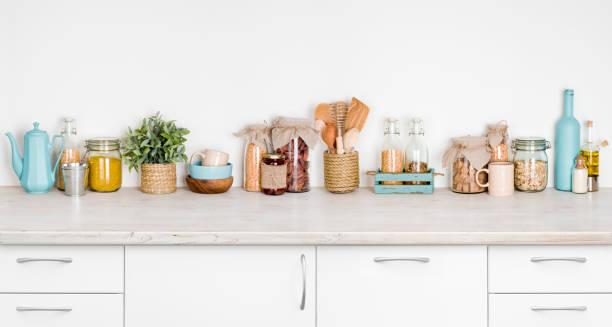 kitchen bench interior with various herbs, spices, utensils on white - przybór kuchenny zdjęcia i obrazy z banku zdjęć