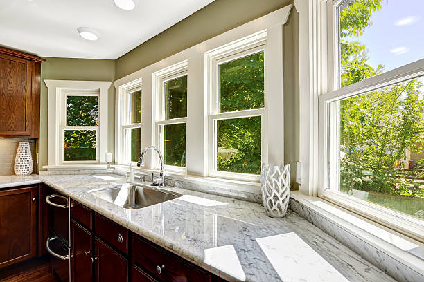 Kitchen cabinet with marble top and sink stock photo