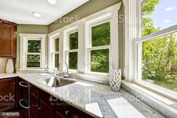 Photo of Kitchen cabinet with marble top and sink