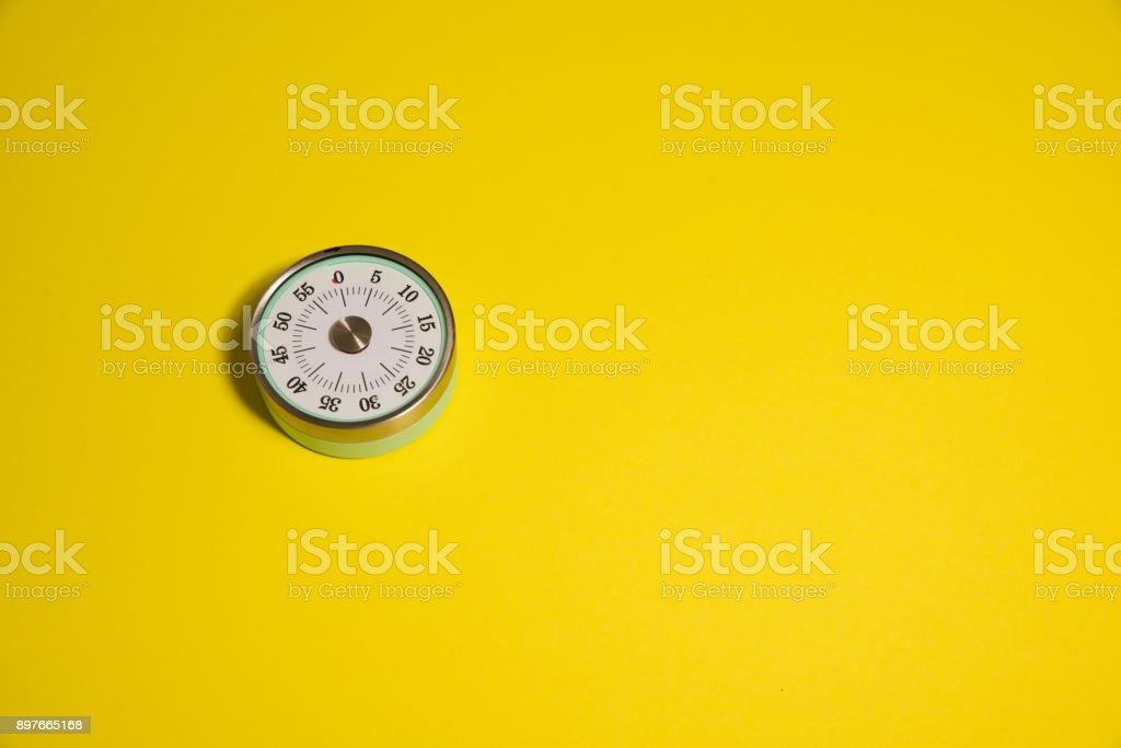 Kitchen Clock on a yellow background stock photo