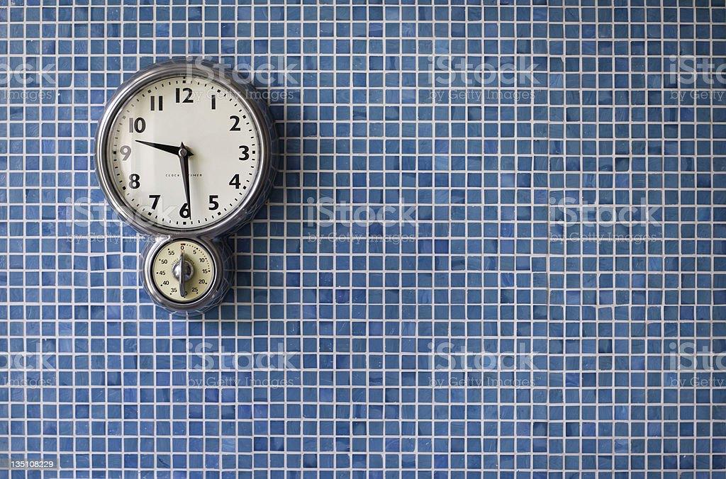 kitchen clock on blue tiles royalty-free stock photo